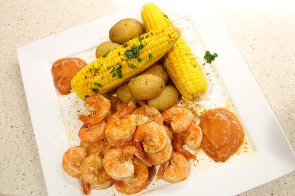 Peel-and-eat shrimp with corn and potatoes.