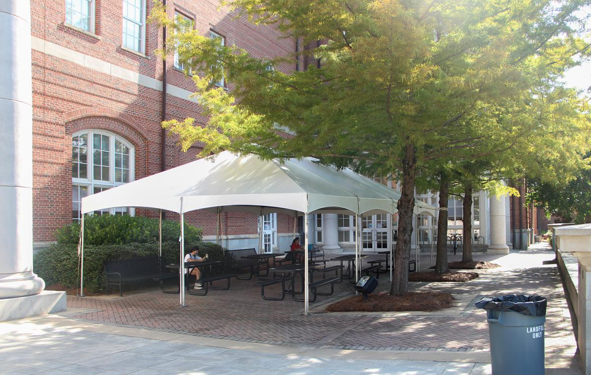 Image of a tent outside of the Miller Learning Center.